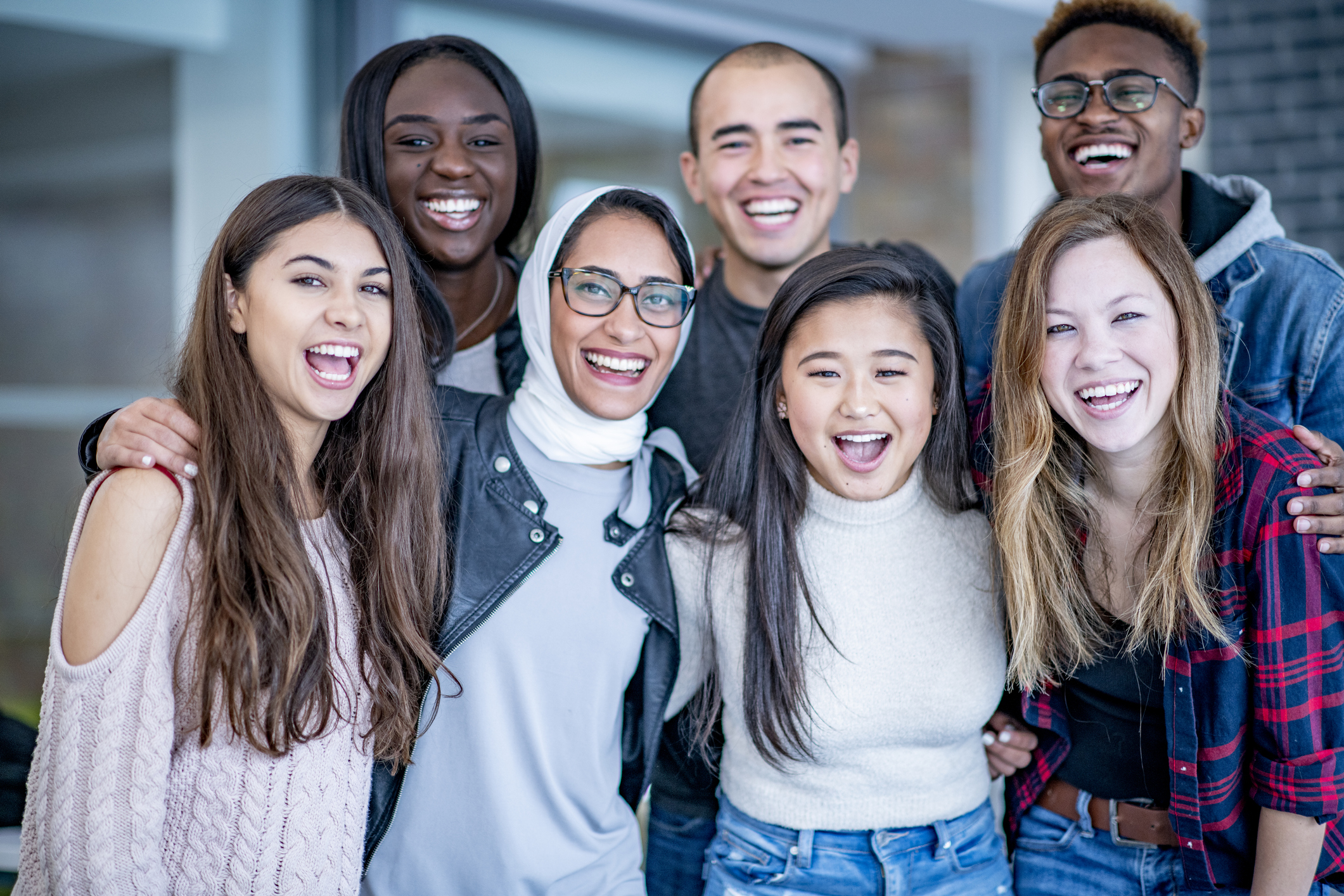 Portrait of a group of students with bright smiles
